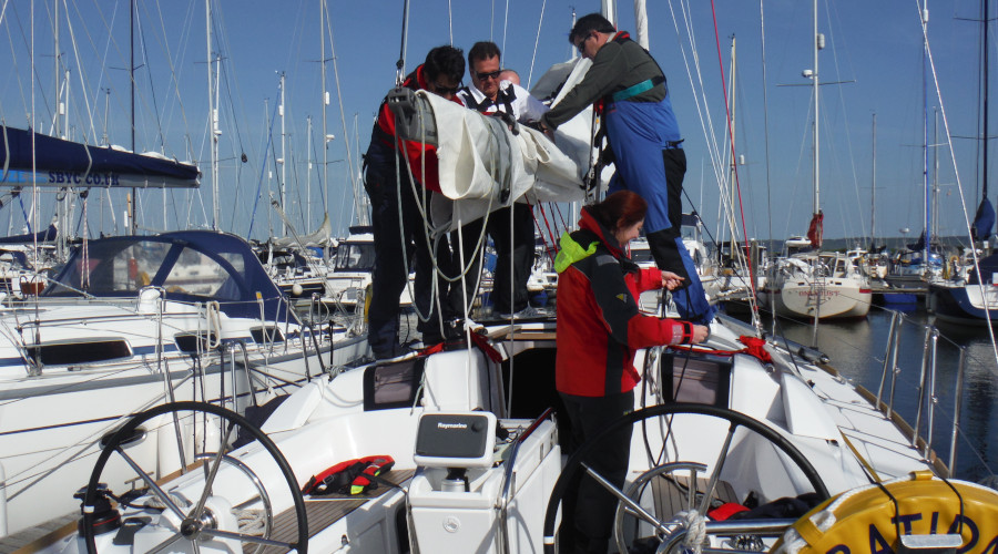 Preparing to go sailing for the day. RYA courses establish a strong routine making it easy to learn