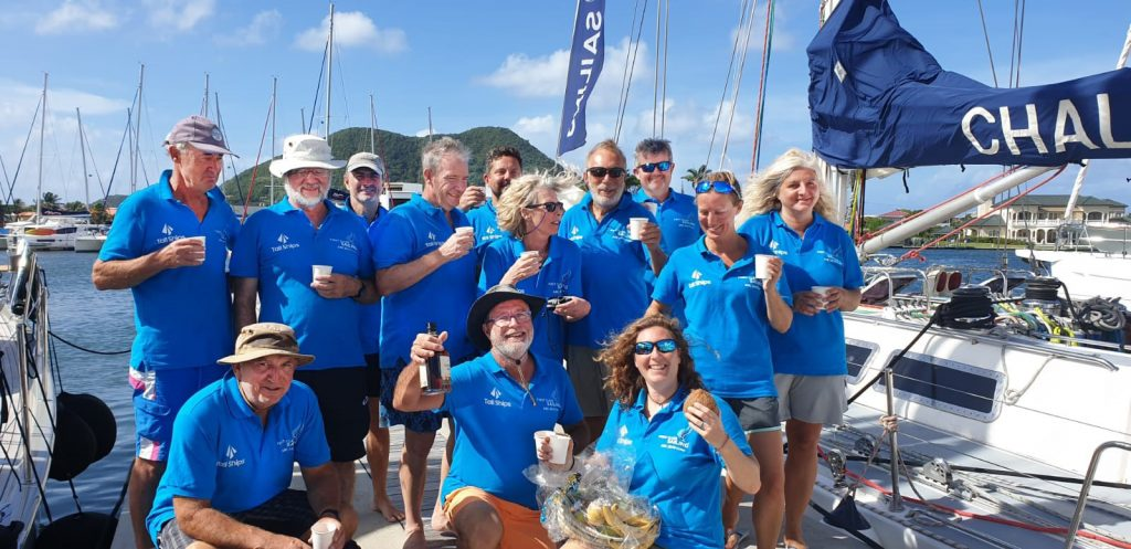 Photo of the First Class Sailing crew at the finish line in St Lucia