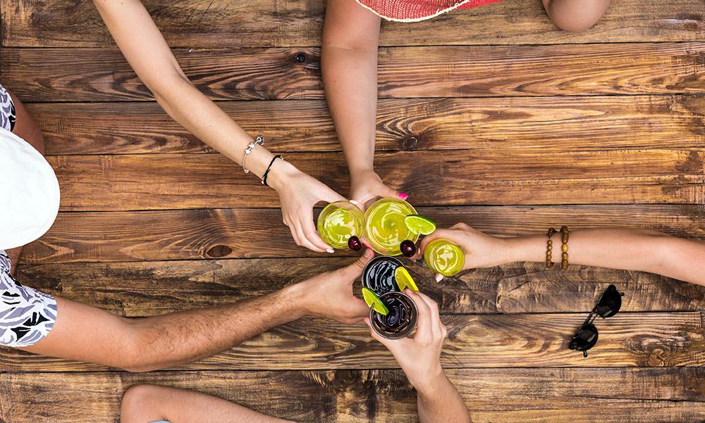 Photo of friends drinking Caribbean rum